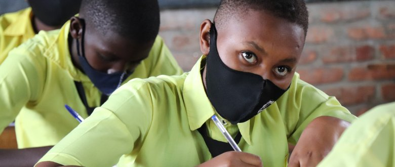 Tesi listening to the teacher during the biology class in Cyinzovu Secondary School, eastern Rwanda