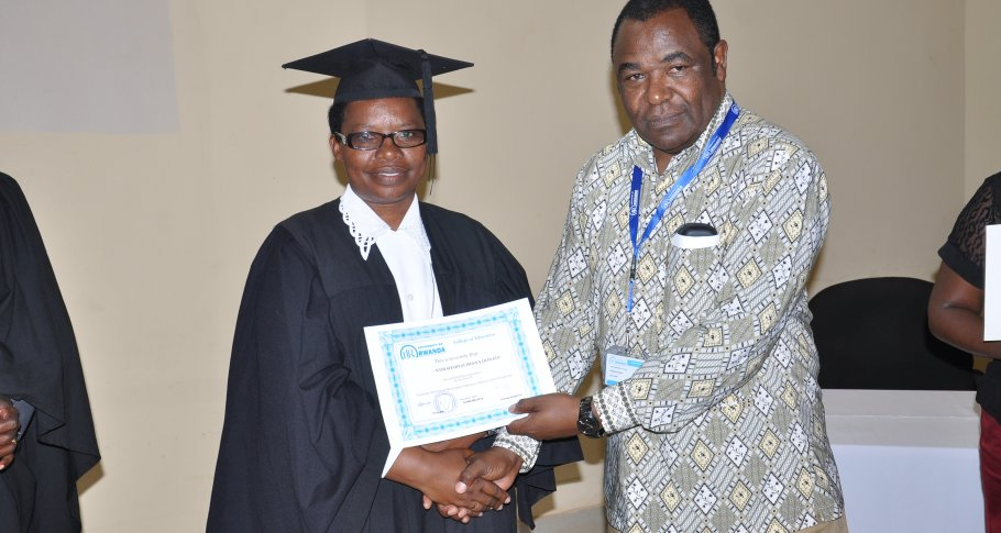 A Graduate receiving her Diploma by the UR-CE Principal