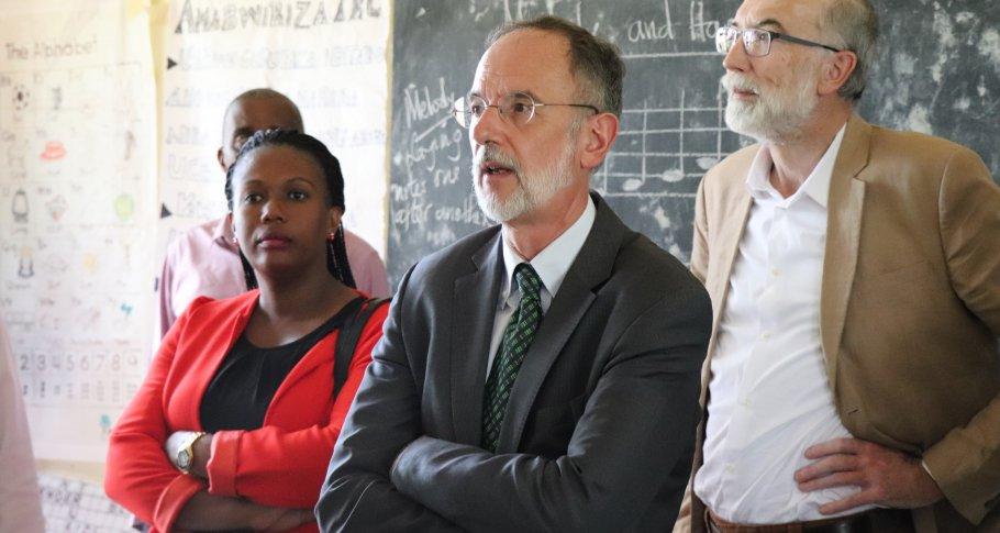 The Ambassador Benoit Ryelandt (centre) interacts with TTC tutors inside a Teacher Resource Centre