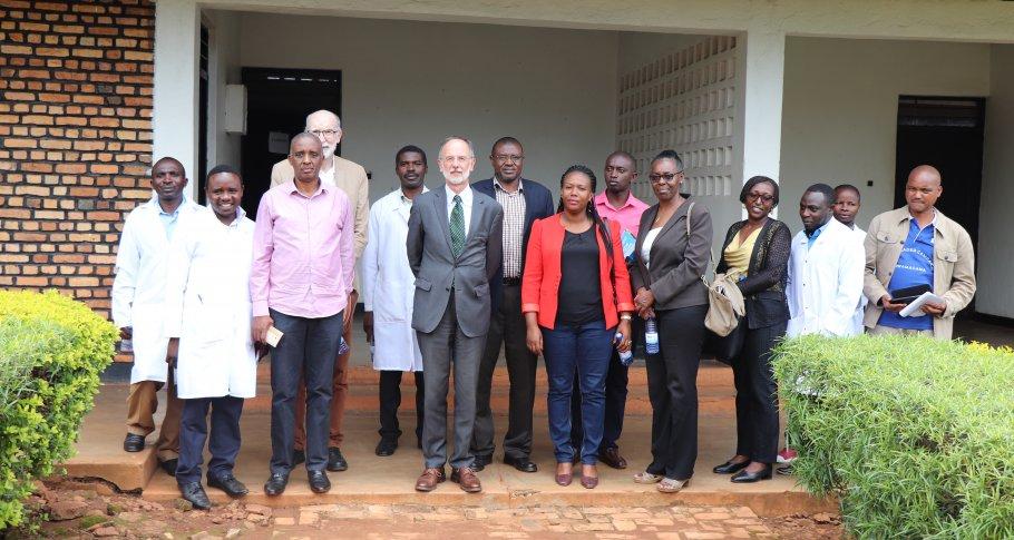 Ambassador Benoit Ryelandt and Johan Debar pose for a group photo at TTC Bicumbi