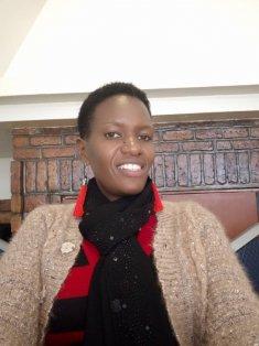 Head Teacher Louise Ayinkamiye  Musanze district
