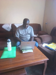 Enock Twebaze follows CPD training from home